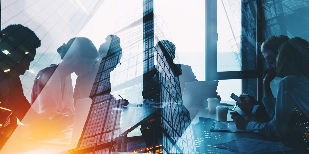 Business people collaborate together in office. Double exposure effects